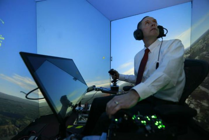 Retired United States Air Force Colonel Gene Lee, in a flight simulator takes on ALPHA. (Image Credit: Lisa Ventre/University of Cincinnati)