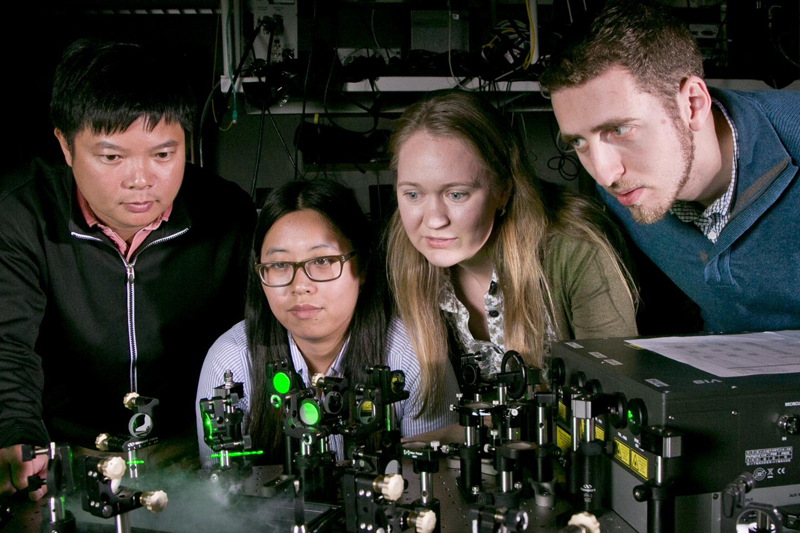 From left to right Thang Hoang, postdoctoral researcher; Jiani Huang, graduate student; Maiken Mikkelsen, professor of electrical and computer engineering and physics and Gleb Akselrod, postdoctoral researcher. Image Credit: Duke University