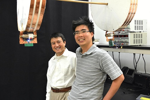 Professor Shanhui Fan (left) and graduate student Sid Assawaworrarit have developed a device that can wirelessly charge a moving object at close range. (Source: Stanford University)