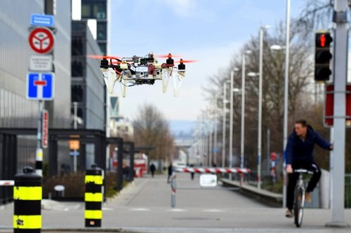 Using training examples from data collected from cars and bikes, drones can navigate streets and indoors. Source: UZH